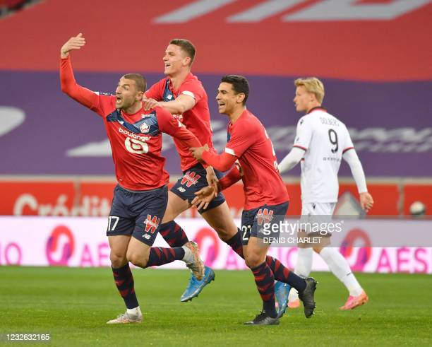 Lille's Forward Burak Yilmaz celebrates a goal during the French L1 football match between Lille and Nice at the Pierre-Mauroy Stadium in Villeneuve...
