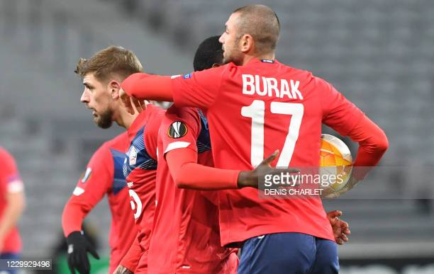 Lille's Forward Burak Yilmaz celebrates after scoring a goal during the UEFA Europa League Group H football match between Lille LOSC and Sparta...