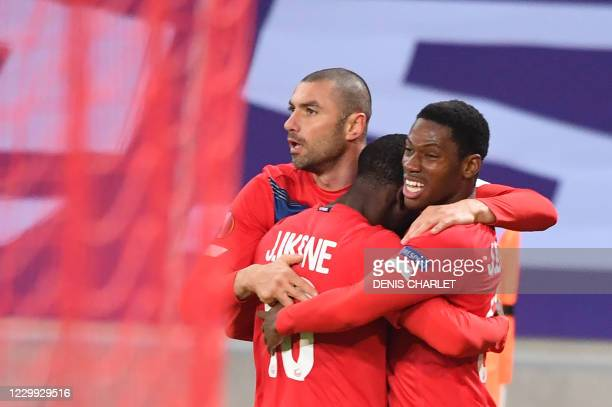 Lille's Forward Burak Yilmaz is congratulated by team mates after scoring a goal during the UEFA Europa League Group H football match between Lille...