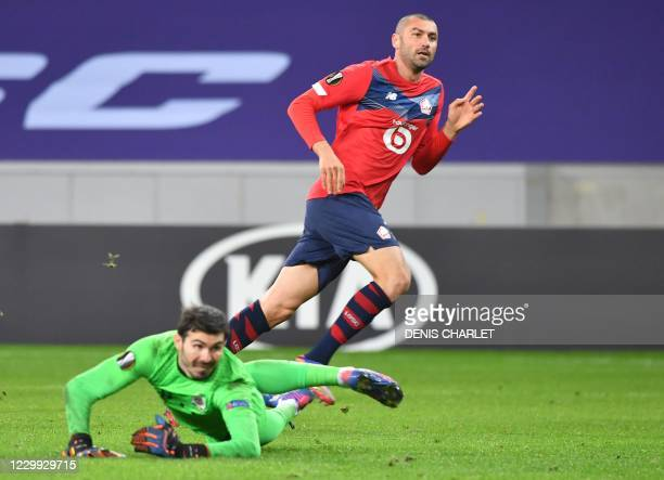 Lille's Forward Burak Yilmaz waches his shot as he scores a goal during the UEFA Europa League Group H football match between Lille LOSC and Sparta...