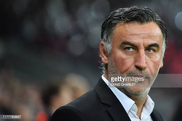 Lille's French coach Christophe Galtier looks on during the UEFA Champions League Group H football match between Lille OSC and Valencia CF at the...