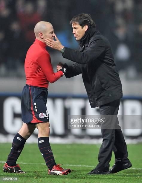 Lille's French coach Rudi Garcia congratulates midfielder Florent Balmont during the Europa League football match Lille vs Slavia Prague on December...