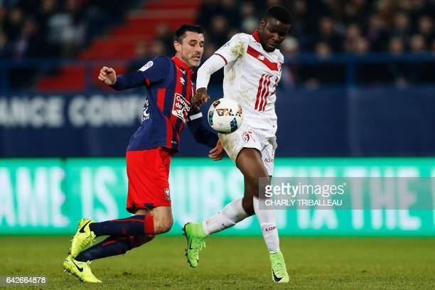 Lille's French defender Adama Soumaoro fights for the ball with Caen's French midfielder Julien Feret during the French L1 football match between...