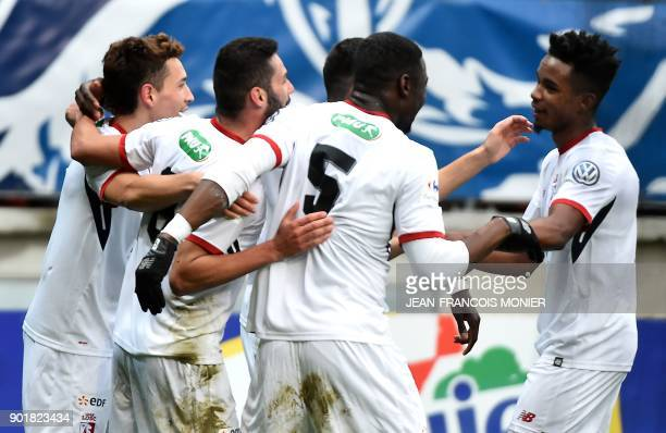 Lille's French defender Adama Soumaoro is congratulated after scoring during the French Cup football match between Le Mans and Lille at MMArena...
