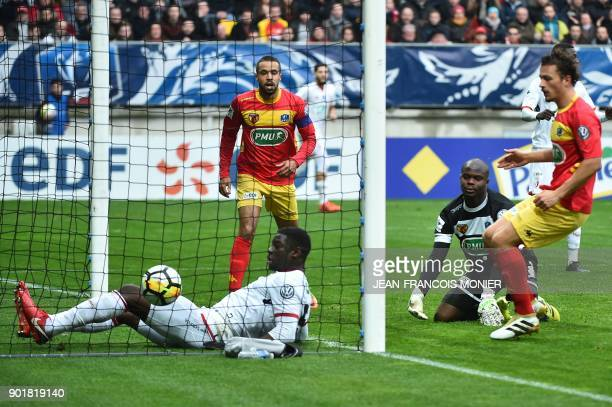 Lille's French defender Adama Soumaoro reacts after scoring Le Mans' French goalkeeper Cedric Mensah during the French Cup football match between Le...