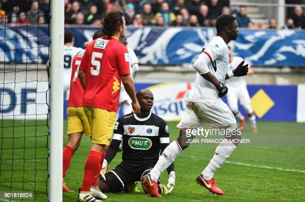 Lille's French defender Adama Soumaoro reacts after scoring next to Le Mans' French goalkeeper Cedric Mensah during the French Cup football match...