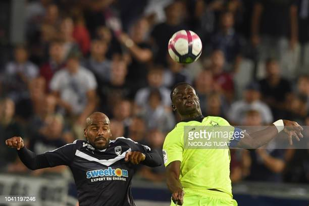 Lille's French defender Adama Soumaoro vies with Bordeaux's French forward Jimmy Briand during the French L1 football match between Bordeaux and...
