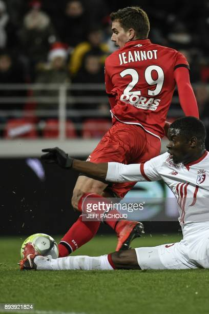 Lille's French defender Adama Soumaoro vies with Dijon's French forward Benjamin Jeannot during the French L1 football match Dijon vs Lille on...