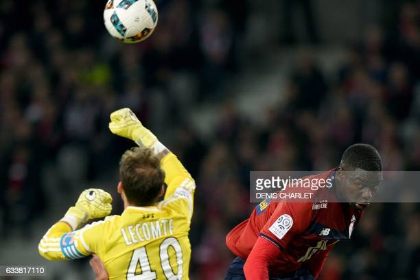 Lille's French defender Adama Soumaoro vies with Lorient's French goalkeeper Benjamin Lecomte during the French Ligue 1 football match between Lille...