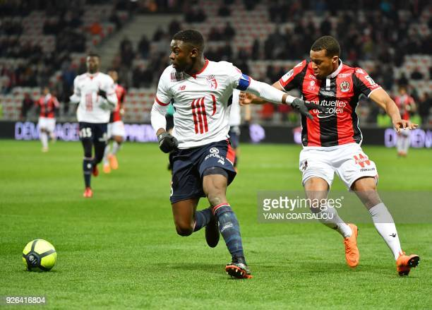 Lille's French defender Adama Soumaoro vies with Nice's French forward Alassane Plea during the French L1 football match Nice vs Lille on March 2...