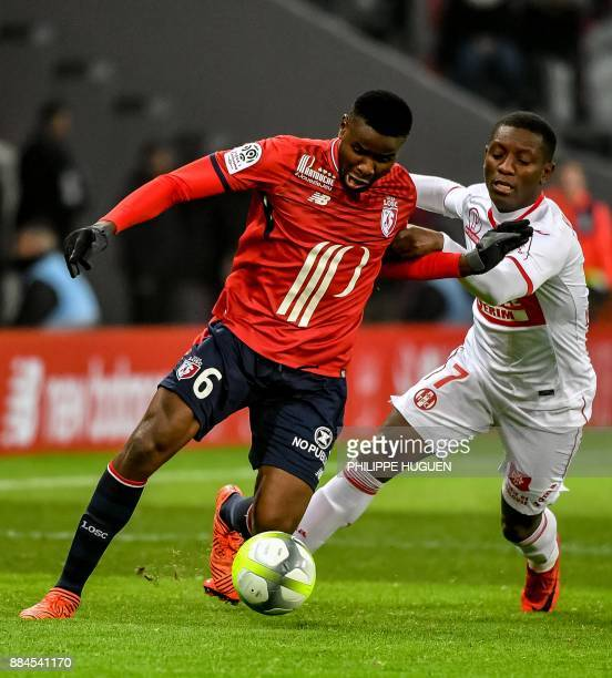 Lille's French defender Adama Soumaoro vies with Toulouse's Ivory Coast midfielder Ibrahim Sangare during the French L1 football match between Lille...