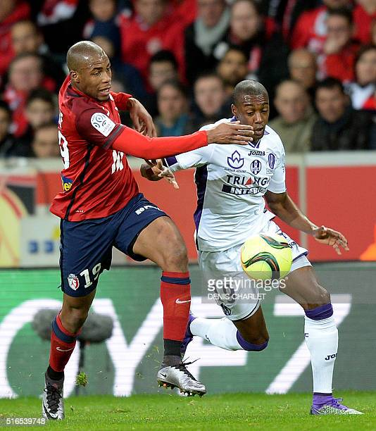 Lille's French defender Djibril Sidibe challenges Toulouse's Brazilian midfielder Somalia during the French L1 football match between Lille and...