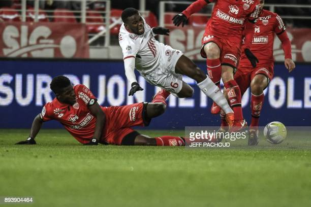 Lille's French defender Ibrahim Amadou is tackled by Dijon's Senegalese defender Hadji Papy Mison Djilobodji during the French L1 football match...