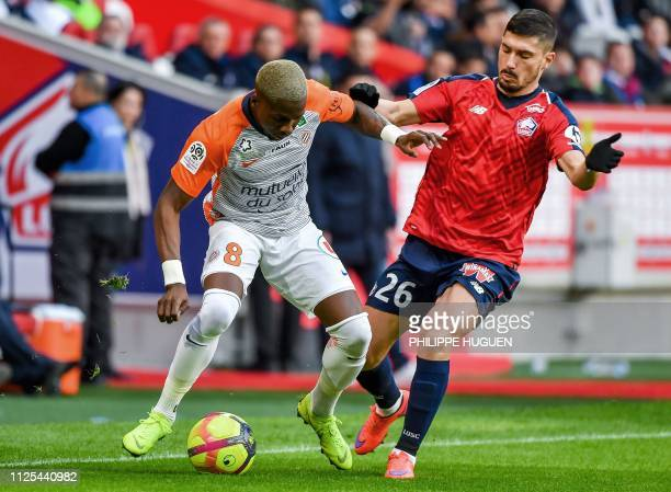 Lille's French defender Jeremy Pied vies with Montpellier's cameroonian defender Ambroise Oyongo during the French L1 football match between Lille...