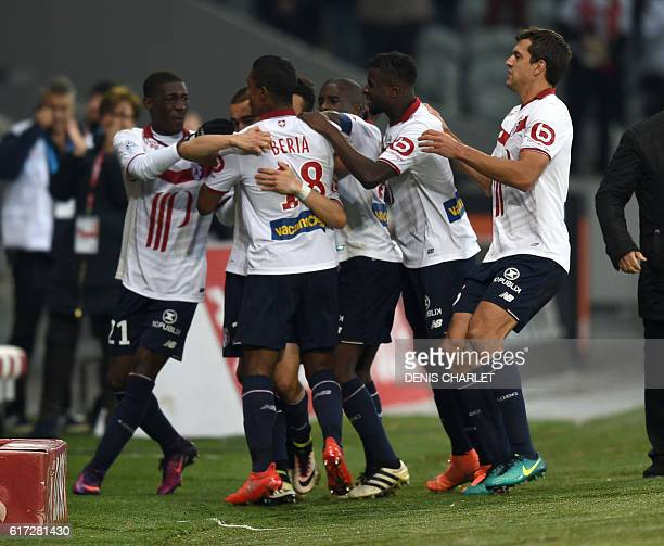 Lille's French defender Sebastien Corchia celebrates with teammates after scoring a goal during the French L1 football match between Lille OSC and...