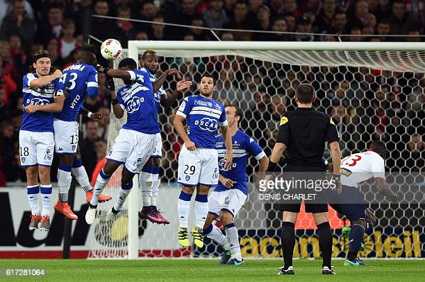 Lille's French defender Sebastien Corchia shoots for the goal during the French L1 football match between Lille OSC and Bastia at the PierreMauroy...