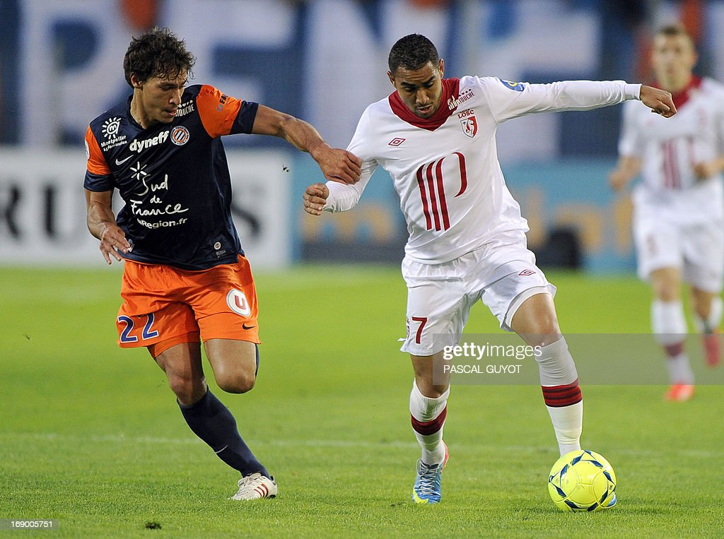 Lille's French forward Dimitri Payet (R) vies with Montpellier's French defender Benjamin Stambouli during the French L1 football match Montpellier vs Lille on May 18, 2013 at the Mosson Stadium in Montpellier, southern France.