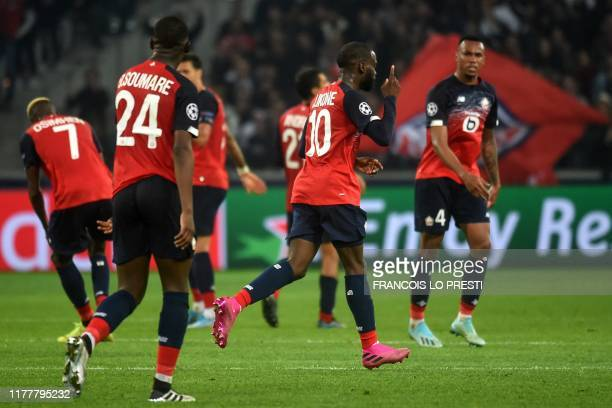Lille's French forward Jonathan Ikone celebrates after scoring a goal during the UEFA Champions League Group H football match between Lille OSC and...