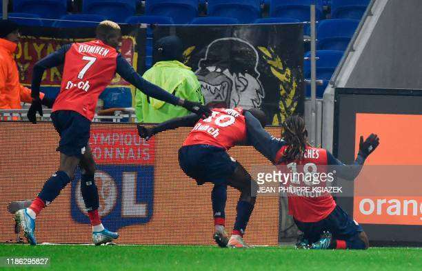 Lille's French forward Jonathan Ikone celebrates with Lille's Nigerian forward Victor Osimhen and Lille's Portuguese midfielder Renato Sanches after...