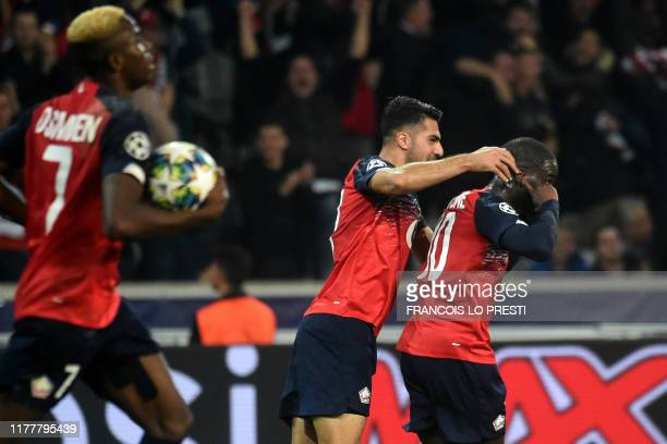 Lille's French forward Jonathan Ikone celebrates with team mates after scoring a goal during the UEFA Champions League Group H football match between...