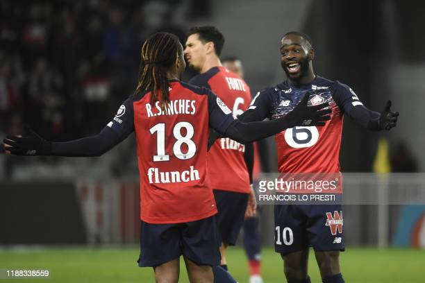 Lille's French forward Jonathan Ikone celebrates with teammate Lille's Portuguese midfielder Renato Sanches after scoring a goal during the French L1...