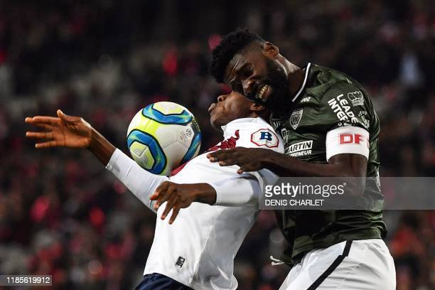 Lille's French forward Jonathan Ikone vies for the ball with Dijon's Gabonese defender Bruno Ecuele Manga during the French L1 football match between...