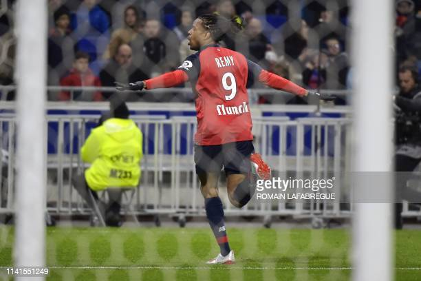 Lille's French forward Loic Remy celebrates after scoring a goal during the French L1 football match between Olympique Lyonnais and Lille on May 5 at...