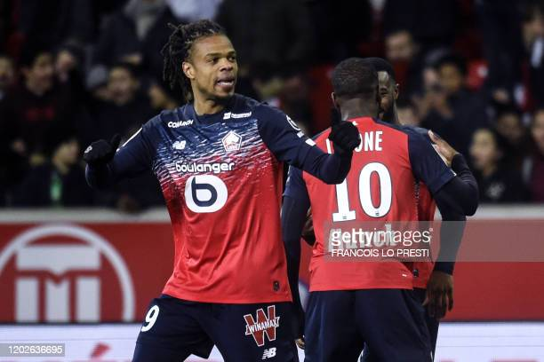 Lille's French forward Loic Remy celebrates after scoring a goal during the French L1 football match between Lille and Toulouse on February 22 at the...