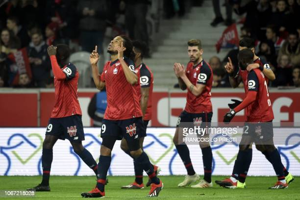 Lille's French forward Loic Remy celebrates with teammates after scoring a goal during the French L1 football match between Lille and Olympique...