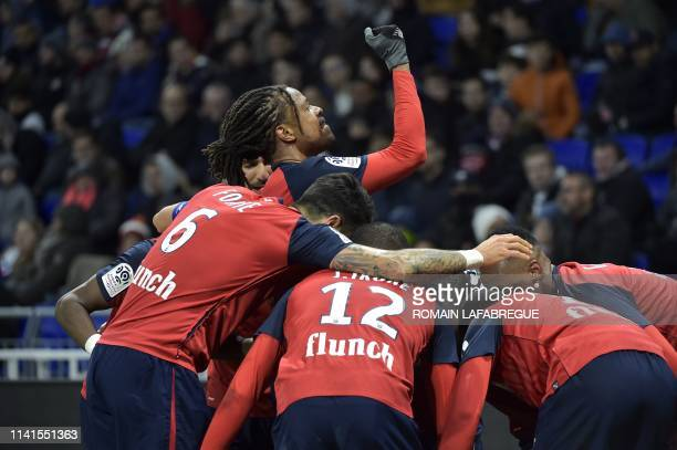 Lille's French forward Loic Remy celebrates with teammates during the French L1 football match between Olympique Lyonnais and Lille on May 5 at the...