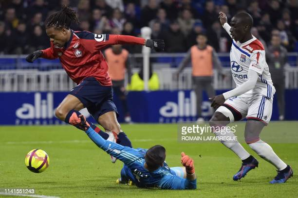 Lille's French forward Loic Remy vies with Lyon's Portuguese goalkeeper Anthony Lopes and Lyon's French defender Ferland Mendy before scoring a goal...