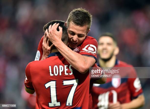 Lille's French forward Nicolas De Preville celebrates with team mate Lille's Portuguese midfielder Rony Lopes after scoring a goal during the French...
