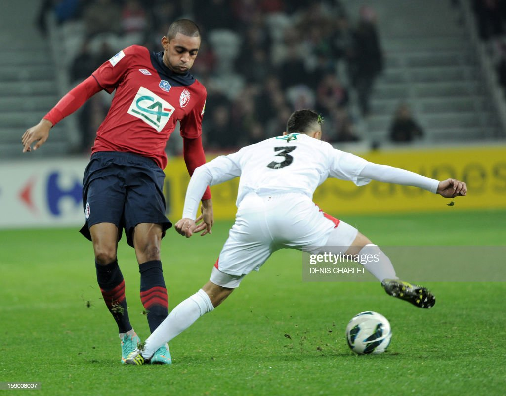 Lille's French forward Ronny Rodelin (L) vies with Nimes' defender Salaheddine Sbai during their French Cup football match between Lille and Nimes at the ''Grand Stade'' on January 5, 2013, in Lille.