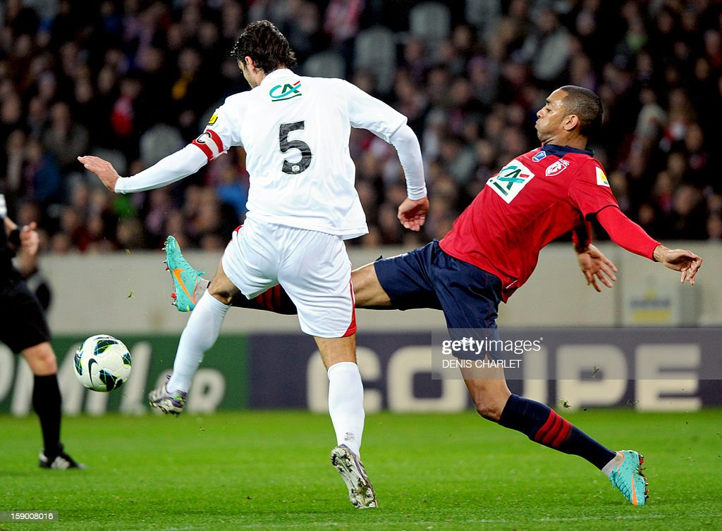 Lille's French forward Ronny Rodelin (L) vies with Nimes's defender Benoit Poulain during their French Cup football match between Lille and Nimes at the Grand Stade, on January 5, 2013, in Lille.