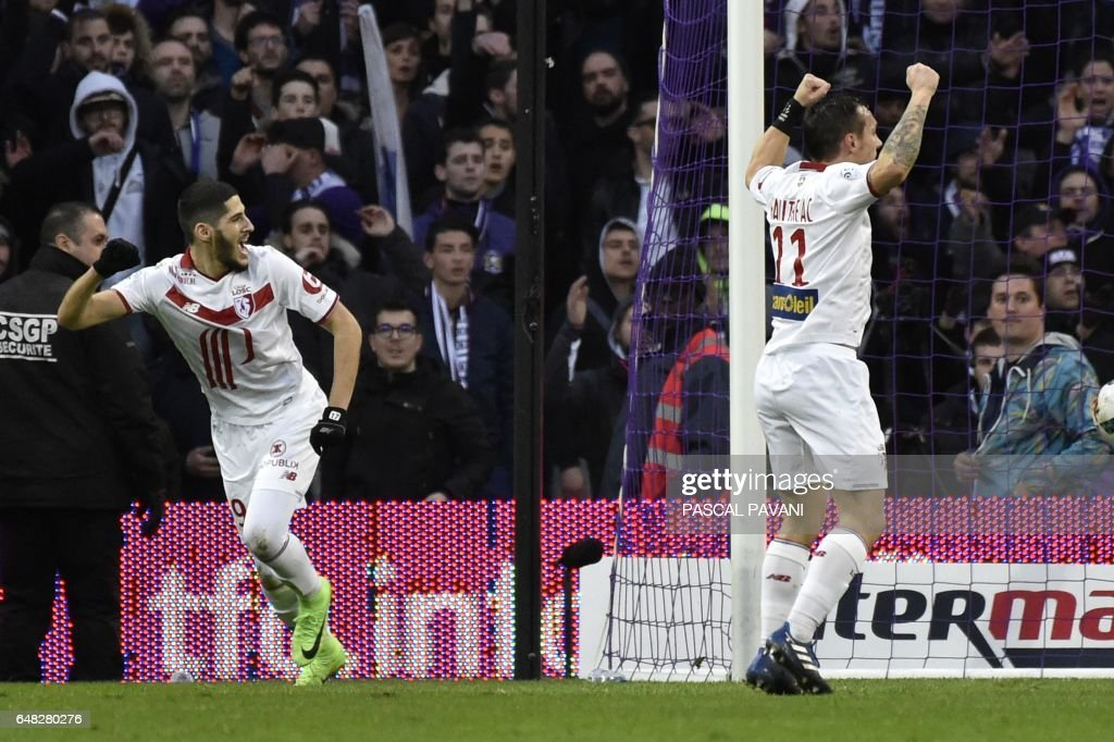 Lille's French forward Yassine Benzia (L) celebrates after scoring a goal during the French L1 football match between Toulouse (TFC) against Lille (LOSC) on March 5, 2017, at the Municipal Stadium in Toulouse, southern France. /