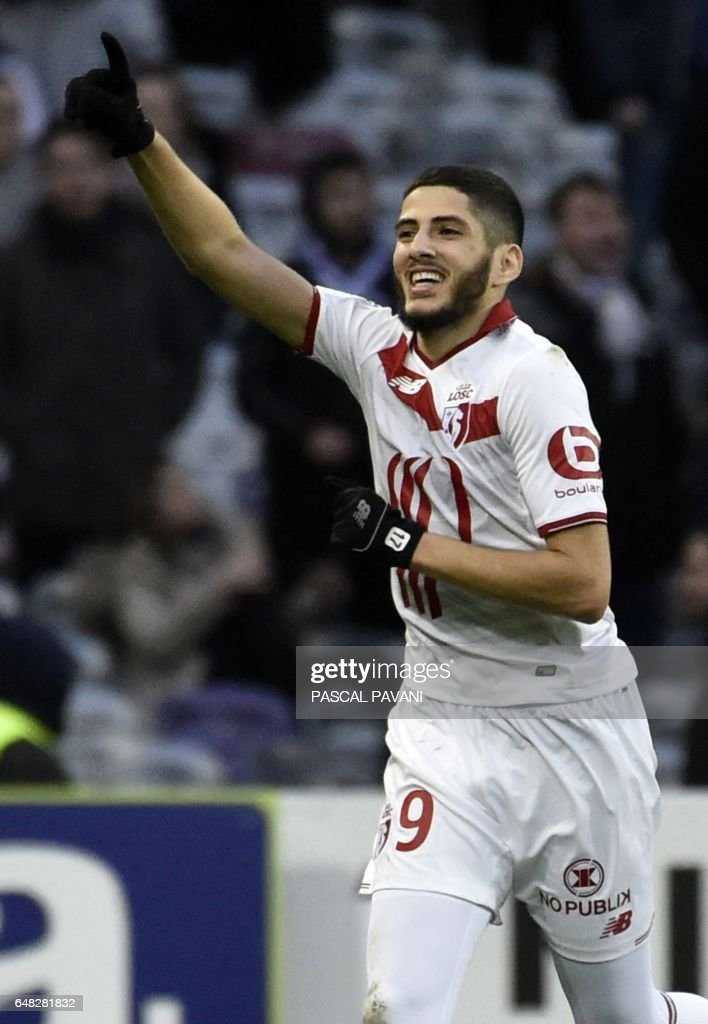 Lille's French forward Yassine Benzia celebrates after scoring a goal during the French L1 football match between Toulouse (TFC) against Lille (LOSC) on March 5, 2017, at the Municipal Stadium in Toulouse, southern France. /