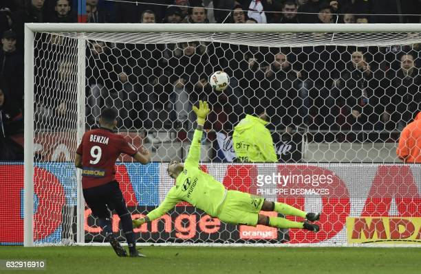 Lille's French forward Yassine Benzia kicks a penalty and scores despite Lyon's FrenchPortuguese defender Anthony Lopes during the French L1 football...