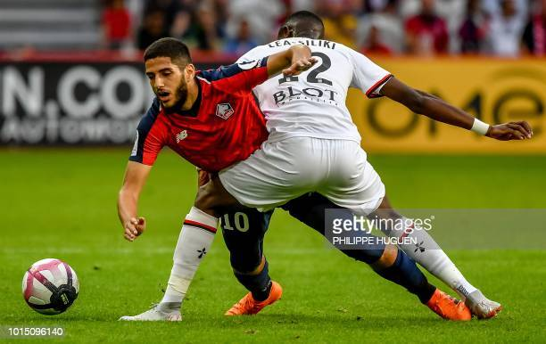 Lille's French forward Yassine Benzia vies with Rennes' French midfielder James LeaSiliki during the French L1 football match between Lille and...