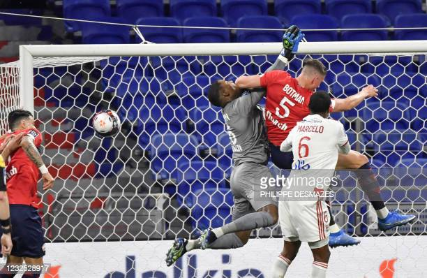 Lille's French goalkeeper Mike Maignan fights with Lyon's Brazilian defender Marcelo as Lille's Dutch defender Sven Botman scores a goal against his...