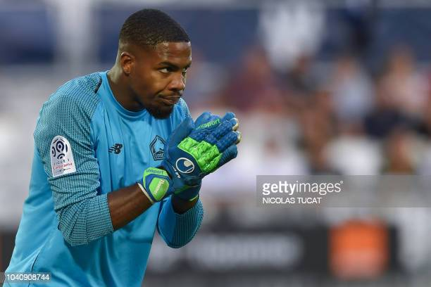Lille's French goalkeeper Mike Maignan looks on during the French L1 football match between Bordeaux and Lille on September 26 2018 at the Matmut...