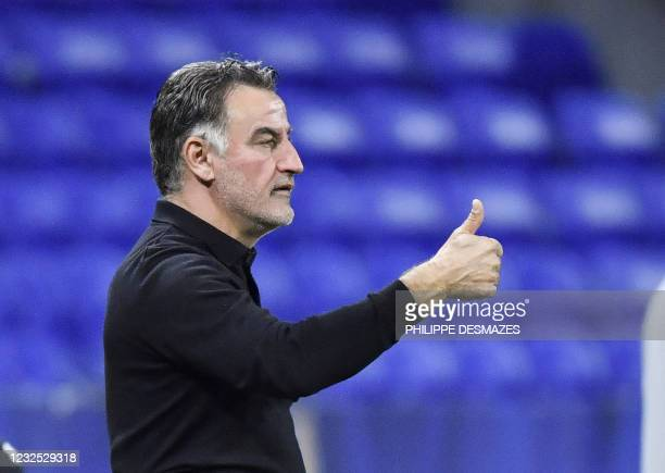 Lille's french head coach Christophe Galtier gestures during the French Ligue 1 football match between Olympique Lyonnais and LOSC Lille at the...