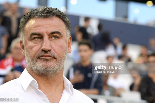 Lille's French head coach Christophe Galtier looks on during the French L1 football match between Bordeaux and Lille on September 26 2018 at the...