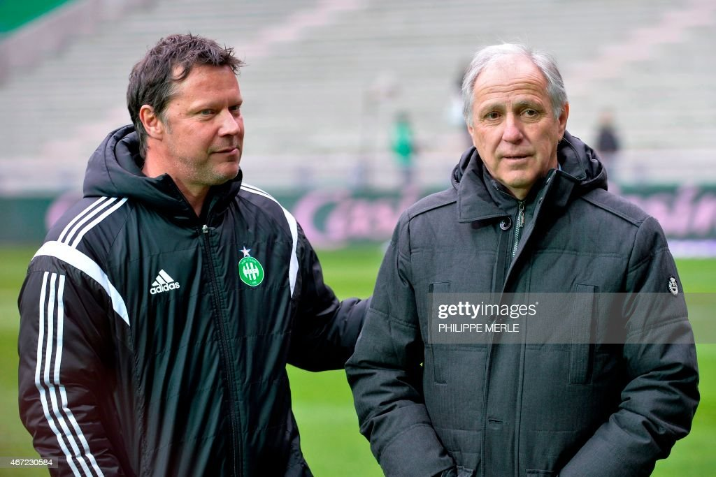 Lille's French head coach Rene Girard (R) talks with Saint-Etienne's French assistant coach Thierry Oleksiak prior to the French L1 football match Saint-Etienne (ASSE) vs Lille (LOSC) on March 22, 2015 at the Geoffroy-Guichard stadium in Saint-Etienne.