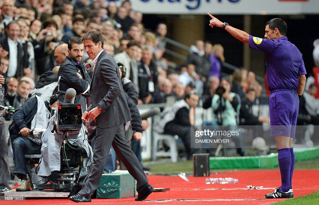Lille's French head coach Rudi Garcia (L) is sent off by referee Nicolas Rainville (R) during the French L1 football match Stade Rennais FC vs Lille LOSC, on September 28, 2012, at the route de Lorient stadium in Rennes, western France.