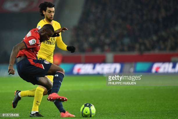 Lille's French midefielder Ibrahim Amadou vies for the ball with Paris SaintGermain's Argentinian midfielder Javier Pastore during French L1 football...