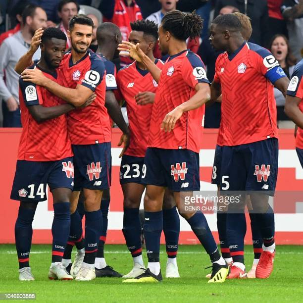 Lille's French midefielder Jonathan Bamba celebrates with teammates after scoring during the French L1 football match between Lille OSC and Saint...