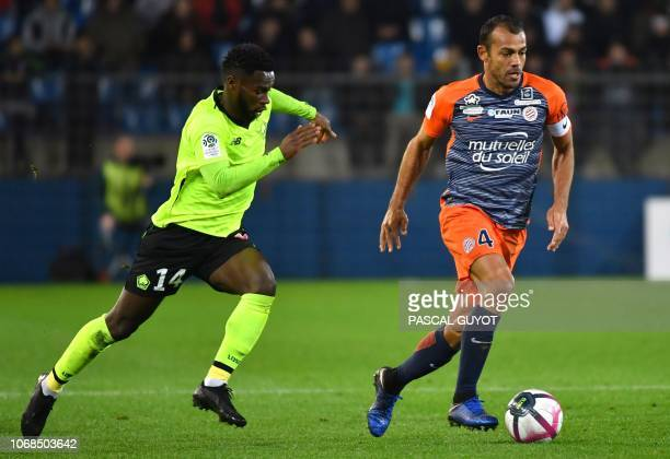 Lille's French midefielder Jonathan Bamba vies with Montpellier's Brazilian defender Vitorino Hilton during the French L1 football match between...