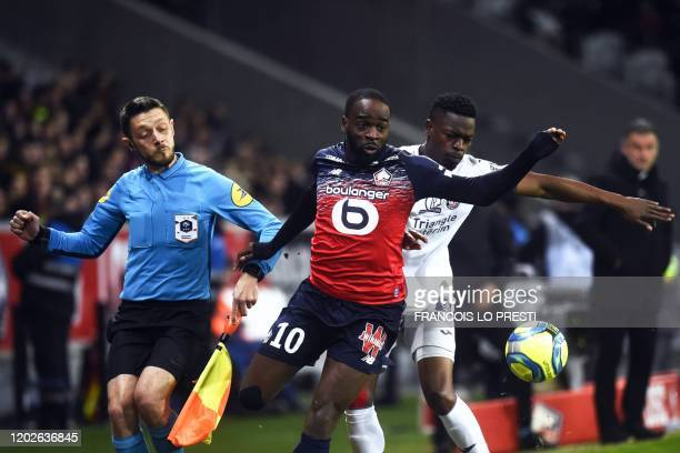 Lille's french midefielder Jonathan Ikone vies with Toulouse' French defender Nicolas Isimat Mirin during the French L1 football match between Lille...
