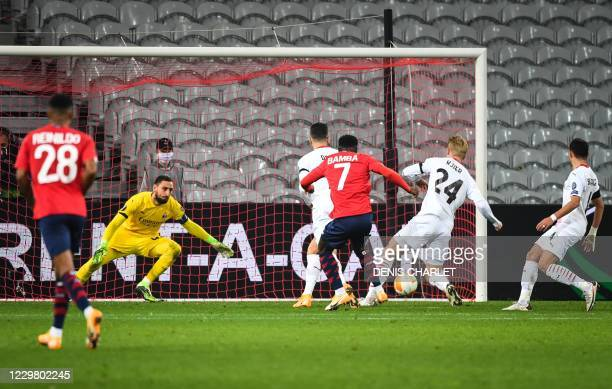 Lille's French midfielder Bamba shoots and scores a goal during the UEFA Europa League Group H football match between Lille LOSC and AC Milan at the...
