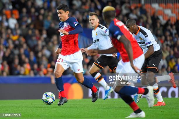Lille's French midfielder Benjamin Andre runs with the ball during the UEFA Champions League group H football match between Valencia CF and Lille...